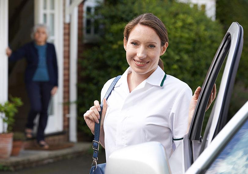 Woman getting in car